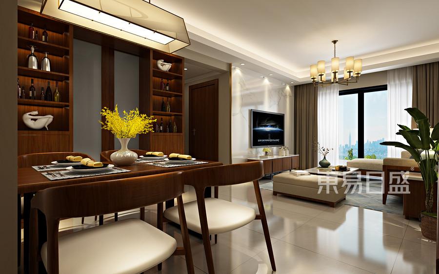 跨越位于客餐厅间的矮柜,落定在对称的餐柜上,开放式的机能设计让客餐厅空间十分宽敞