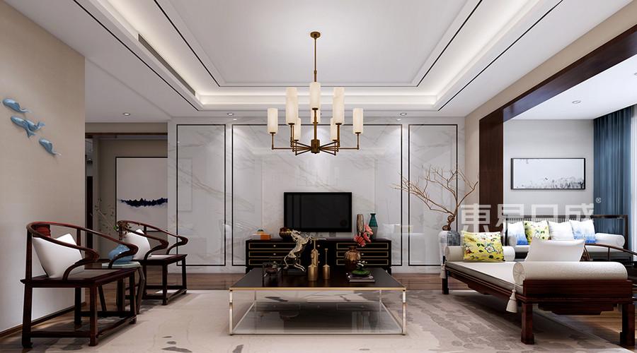 电视墙用浅色石材加不锈钢线条做造型,整体简单大气.