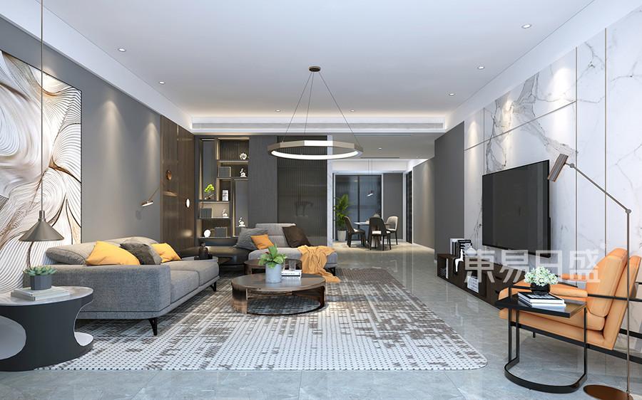 效果图:电视墙的白色石材拼贴和地毯沙发的冷暖色的搭配,和背景墙地砖